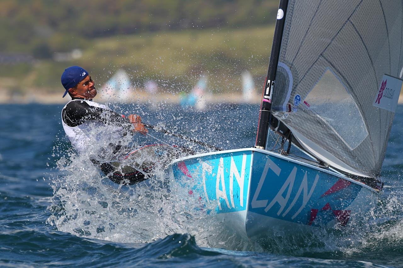 WEYMOUTH, ENGLAND - JULY 29: Greg Douglas from Canada in action sailing the Finn class during the London 2012 Olympic Games at the Weymouth & Portland Venue at Weymouth Harbour on July 29, 2012 in Weymouth, England.  (Photo by Richard Langdon/Getty Images)