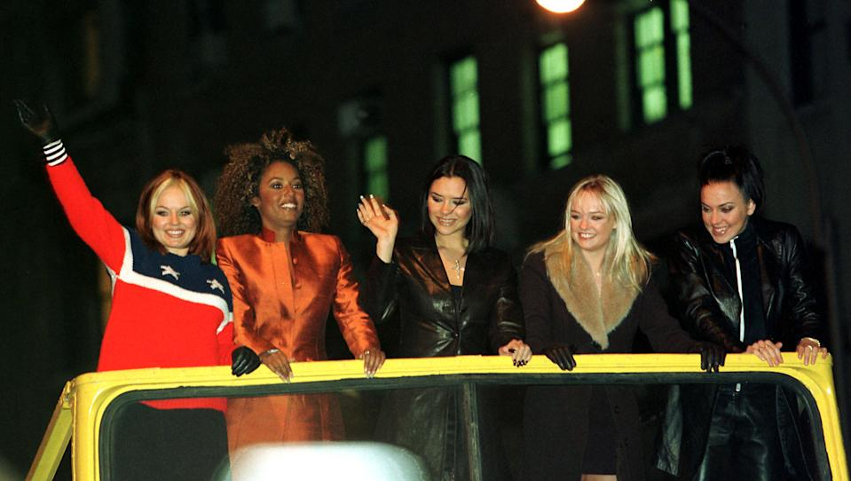 The group the Spice Girls arrive on a double decker bus at New York's Planet Hollywood, January 14. The Spice Girls were making an appearance at the theme restaurant to donate memorabilia from their new movie