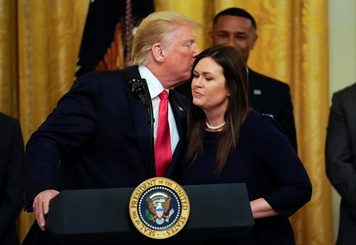 President Trump with White House press secretary Sarah Sanders after it was announced she will leave her position at the end of the month, June 13, 2019. (Photo: Kevin Lamarque/Reuters)