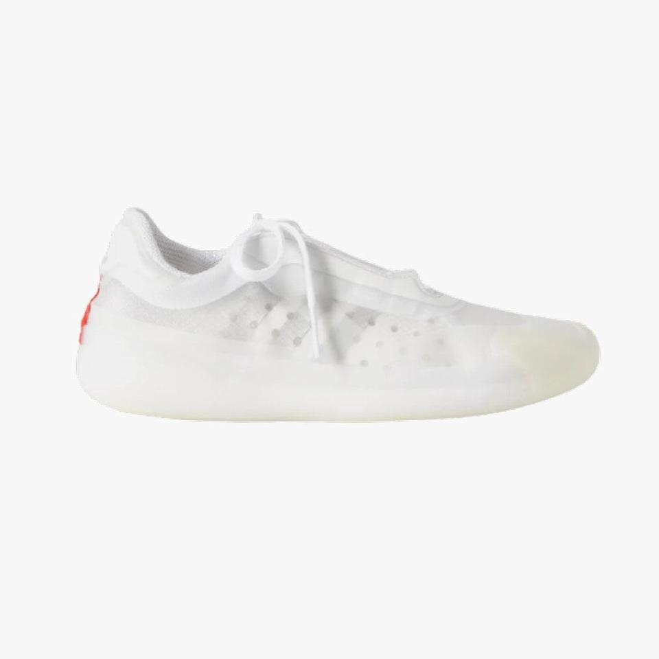 "$695, NET-A-PORTER. <a href=""https://www.net-a-porter.com/en-us/shop/product/adidas-originals/prada-neoprene-and-mesh-sneaker/1286168"" rel=""nofollow noopener"" target=""_blank"" data-ylk=""slk:Get it now!"" class=""link rapid-noclick-resp"">Get it now!</a>"