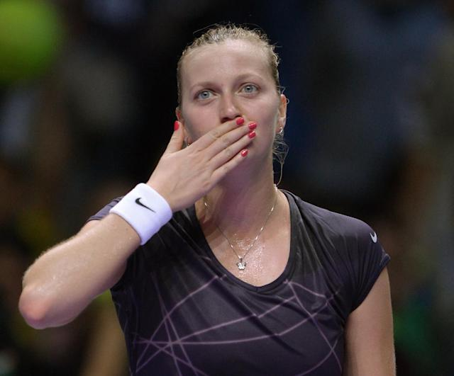 Petra Kvitova of Czech Republic gestures, after defeating Angelique Kerber of Germany during their tennis match at the WTA Championship in Istanbul, Turkey, Friday, Oct. 25, 2013. The world's top female tennis players compete in the championships which runs from Oct. 22 until Oct. 27. (AP Photo)