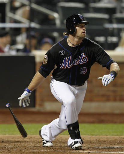 New York Mets center fielder Kirk Nieuwenhuis follows through on his two-run home run in the fourth inning of a baseball game against the St. Louis Cardinals, Sunday, June 3, 2012, in New York. (AP Photo/Kathy Willens)