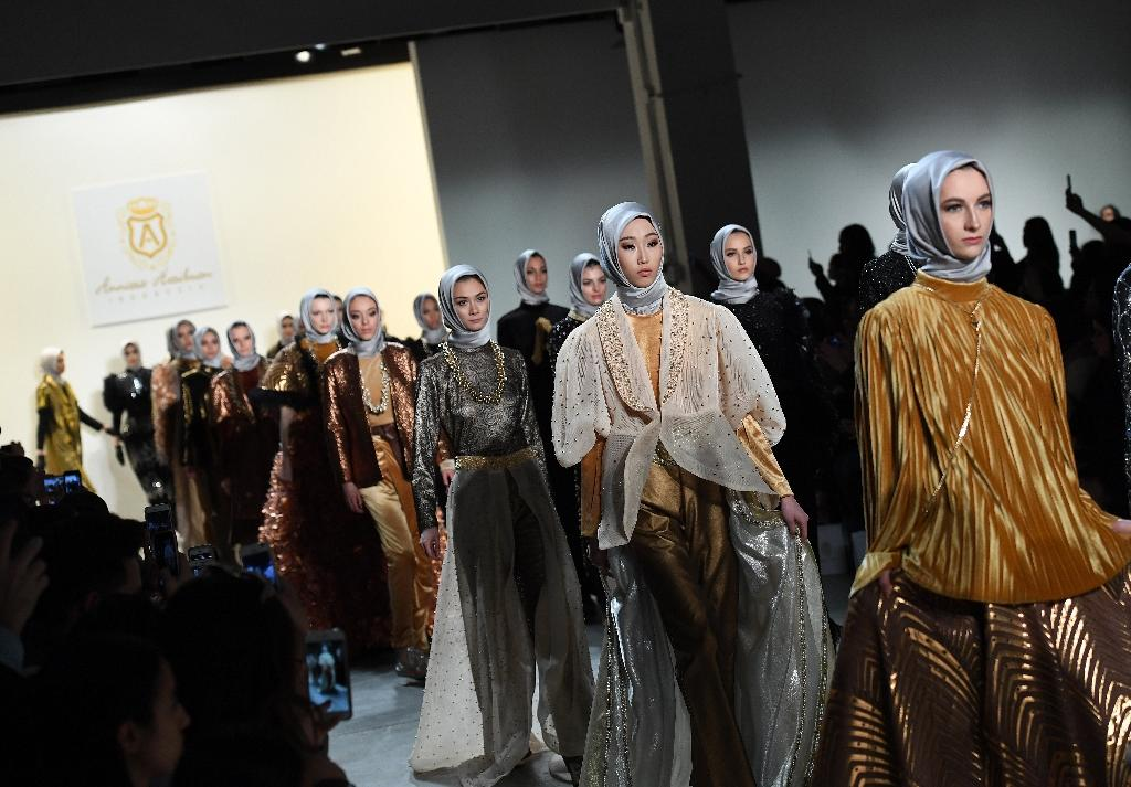 "Indonesian Muslim designer Anniesa Hasibuan held casting calls specifically seeking first and second-generation immigrants, seeking to show that ""fashion is for everybody"" (AFP Photo/Angela Weiss)"