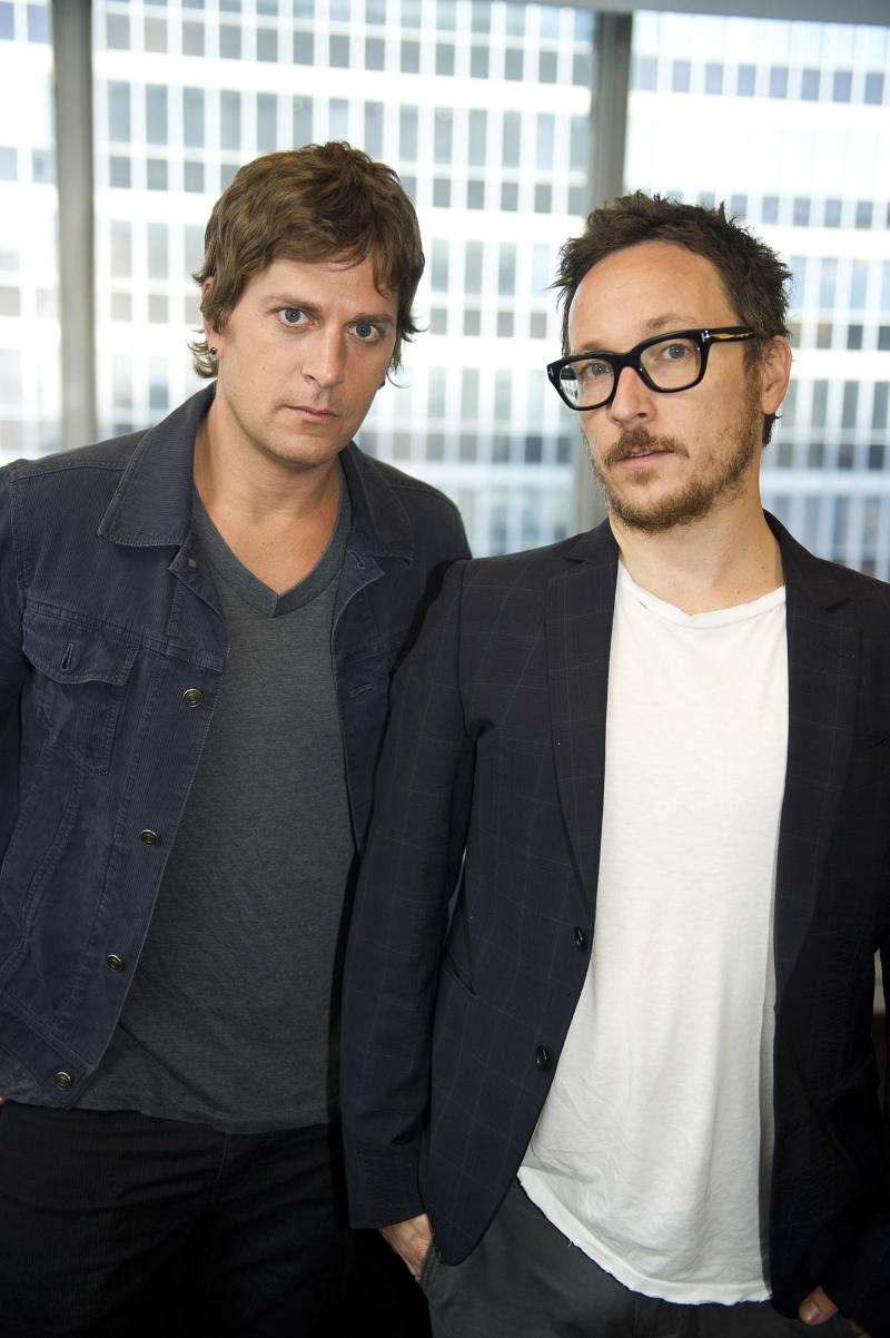 """This July 10, 2012 photo shows Rob Thomas, left, and Paul Doucette of Matchbox Twenty in New York. Matchbox Twenty's new album, """"North,"""" debuted at No. 1 on Billboard's 200 albums chart this week. It is the band's first full-length album since 2002's """"More Than You Think You Are."""" (Photo by Charles Sykes/Invision/AP)"""