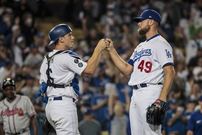 Los Angeles, CA, Monday, August 30, 2021 - Los Angeles Dodgers relief pitcher Blake Treinen (49) and Los Angeles Dodgers catcher Will Smith (16) celebrate after completing a 5-3 win over the Atlanta Braves at Dodger Stadium. (Robert Gauthier/Los Angeles Times)