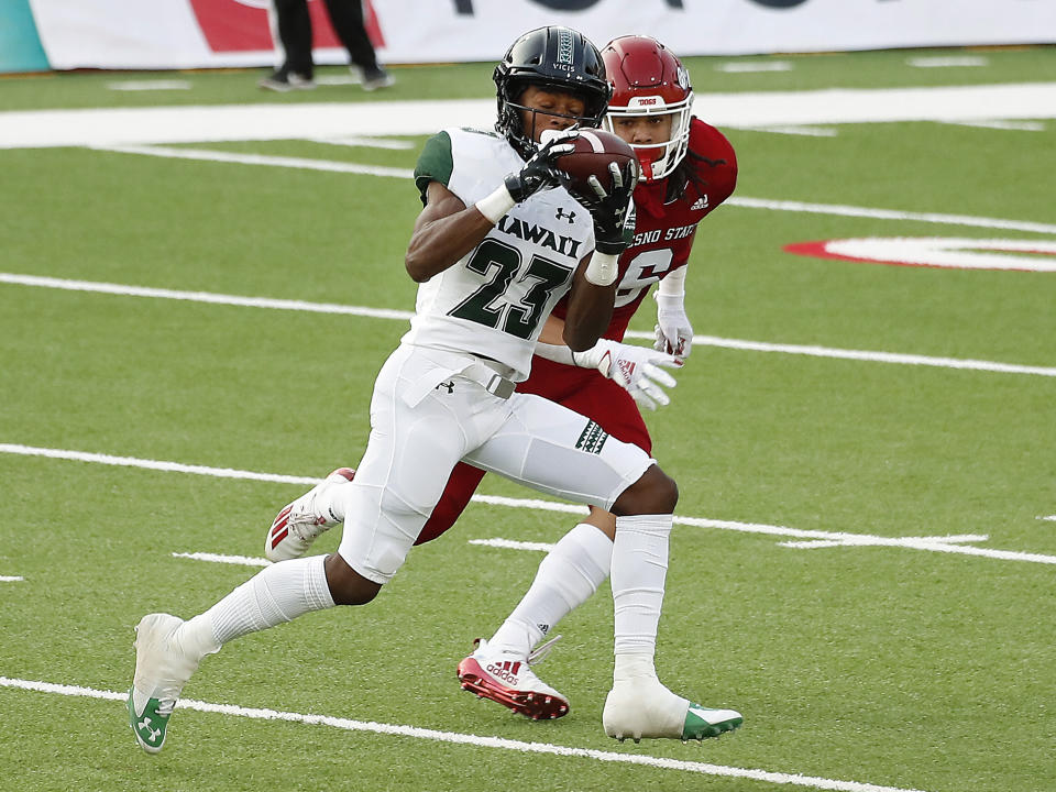 Hawaii wide receiver Jared Smart catches a long pass past Fresno State defensive back Levelle Bailey during the first half of an NCAA college football game in Fresno, Calif., Saturday, Oct. 24, 2020. (AP Photo/Gary Kazanjian)