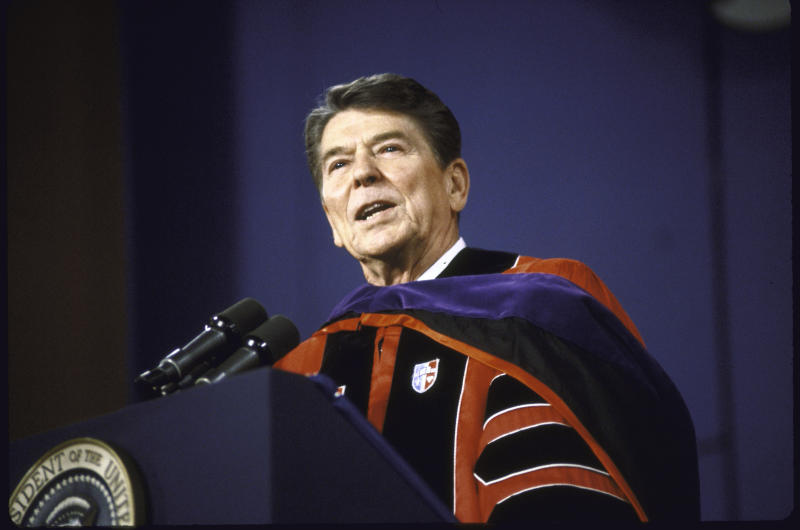 US Pres. Ronald W. Reagan wearing university robe and speaking at St John's University regarding reception of honarary degree. (Photo by Diana Walker//The LIFE Images Collection via Getty Images)