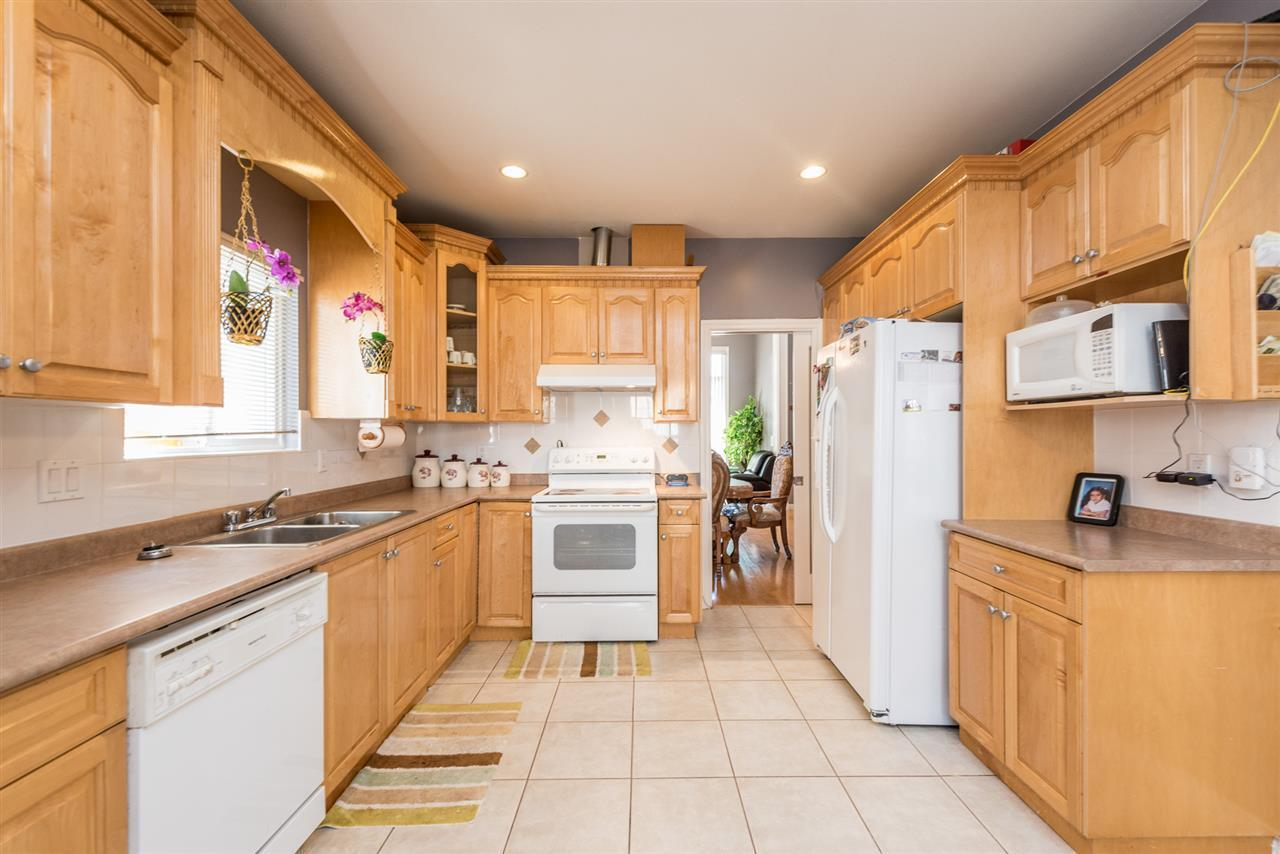 """<p><a rel=""""nofollow"""">14603 67A Ave., Surrey, B.C.</a><br /> In the kitchen, the stove, refrigerator and dishwasher are all included with the home.<br /> (Photo: Zoocasa) </p>"""