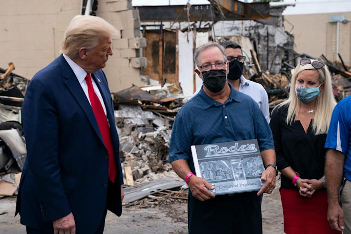 Kenosha man shown with president is former owner