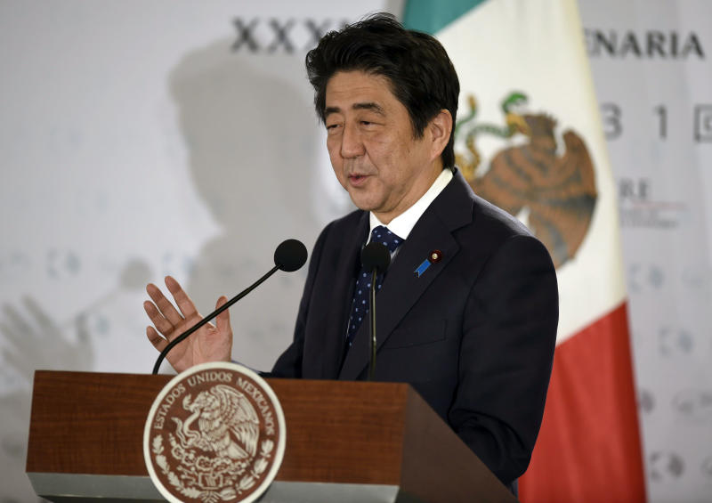 Japanese Prime Minister Shinzo Abe delivers a speech at the Industriales Club in Mexico City, on July 25, 2014