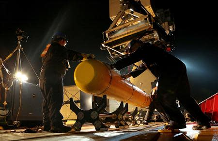 The Phoenix International Autonomous Underwater Vehicle (AUV) Artemis, also known as the Bluefin-21, is prepared for deployment from the Australian Defence Vessel Ocean Shield in the search for missing Malaysia Airlines Flight MH370 in the Southern Indian Ocean in this undated picture released on April 21, 2014 by the Australian Defence Force. REUTERS/Australian Defence Force/Handout via Reuters