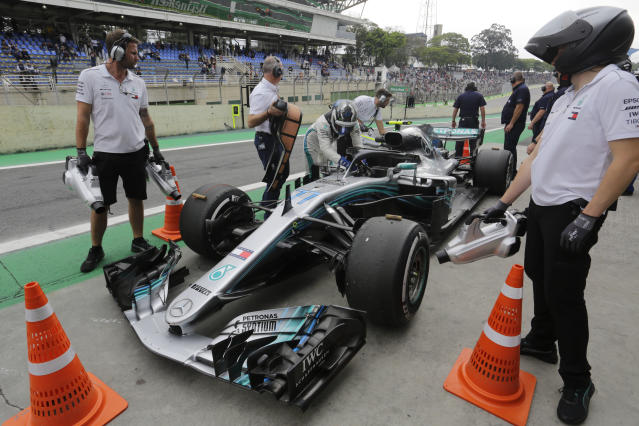 Mercedes Valtteri Bottas, of Finland, gets out of his car after the second free practice at the Interlagos race track in Sao Paulo, Brazil, Friday, Nov. 9, 2018. (AP Photo/Nelson Antoine)