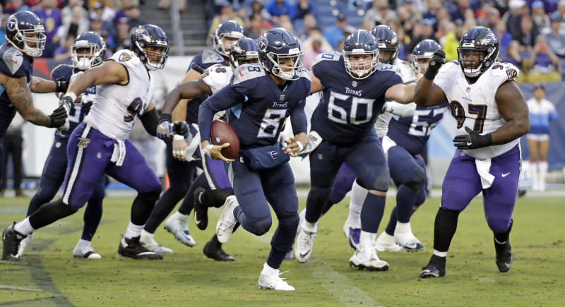 Tennessee Titans quarterback Marcus Mariota (8) scrambles against the Baltimore Ravens in the second half of an NFL football game Sunday, Oct. 14, 2018, in Nashville, Tenn. (AP Photo/James Kenney)