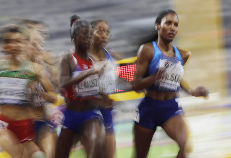 Ajee Wilson, of the United States, leads a the women's 800 meter semifinal at the World Athletics Championships in Doha, Qatar, Saturday, Sept. 28, 2019. (AP Photo/Petr David Josek)