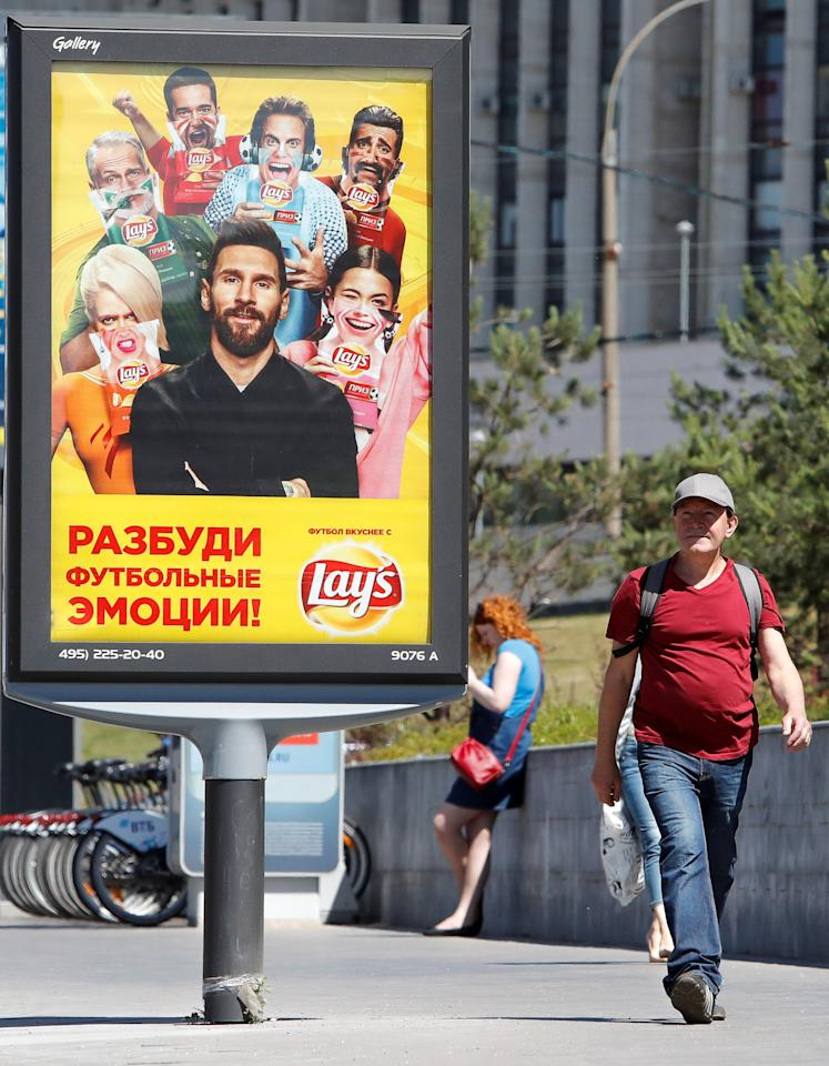 A man walks past an advertisement poster depicting Argentina's soccer player Lionel Messi in Moscow, Russia June 20, 2018. Picture taken June 20, 2018. REUTERS/Sergei Karpukhin