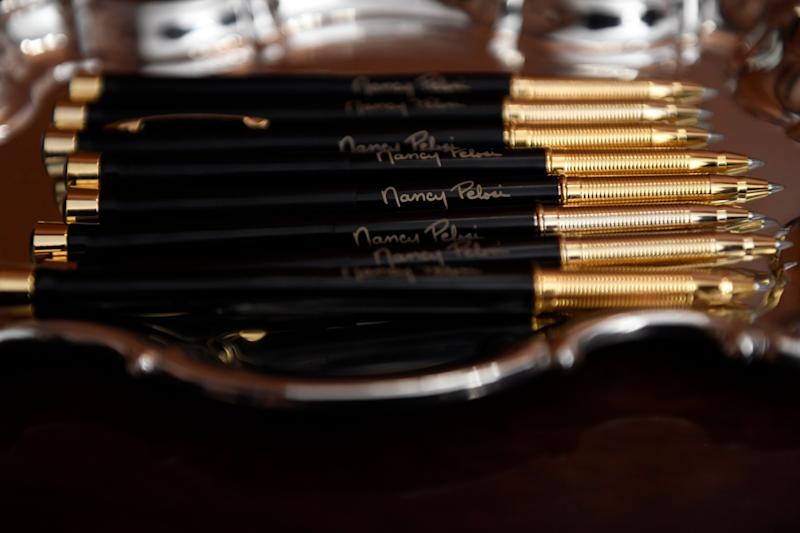 The pens that House Speaker Nancy Pelosi of Calif., will use to sign the resolution to transmit the two articles of impeachment against President Donald Trump to the Senate for trial on Capitol Hill in Washington, Wednesday, Jan. 15, 2020. . (AP Photo/Susan Walsh) (Photo: ASSOCIATED PRESS)