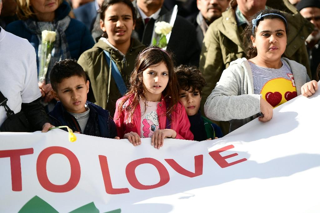 Children carry a banner during a commemorative march as Belgium marks the first anniversary of the twin Brussels attacks by Islamic extremists on March 22, 2017 in Brussels (AFP Photo/Emmanuel DUNAND)