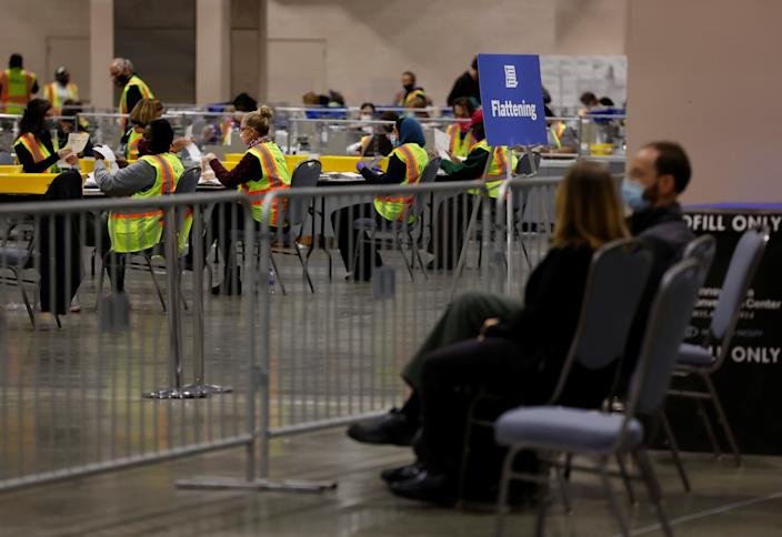 Poll watchers observe as votes are counted at the Pennsylvania Convention Center on Election Day.