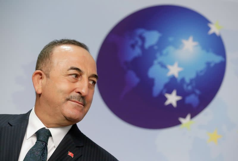 FILE PHOTO: FILE PHOTO: Turkish Foreign Minister Mevlut Cavusoglu looks on as he gives a joint statement with High Representative of the European Union for Foreign Affairs and Security Policy Josep Borrell (not pictured)