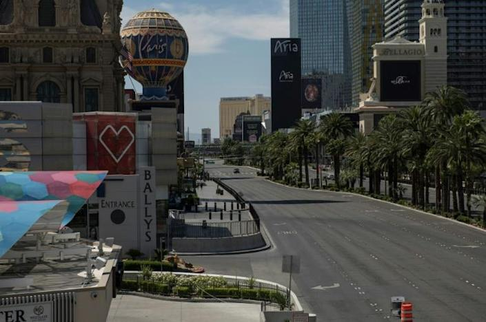 A car drives down the Las Vegas strip, which the pandemic has deprived of its drunken revelers and packed poker tables (AFP Photo/Bridget BENNETT)