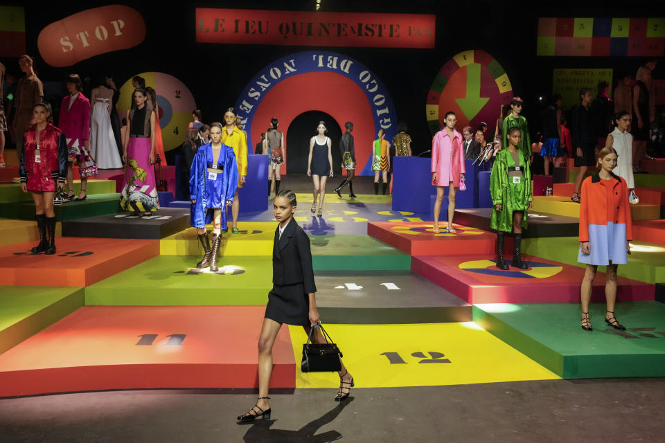 Models wear creations for the Dior Spring-Summer 2022 ready-to-wear fashion show presented Tuesday, Sept. 28, 2021, in Paris. (AP Photo/Francois Mori)