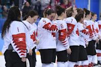 <p>The Canada team reacts on the podium during the medal ceremony after getting the silver medal in the women's ice hockey event during the Pyeongchang 2018 Winter Olympic Games at the Gangneung Hockey Centre in Gangneung on February 22, 2018. / AFP PHOTO / JUNG Yeon-Je (Photo credit should read JUNG YEON-JE/AFP/Getty Images) </p>