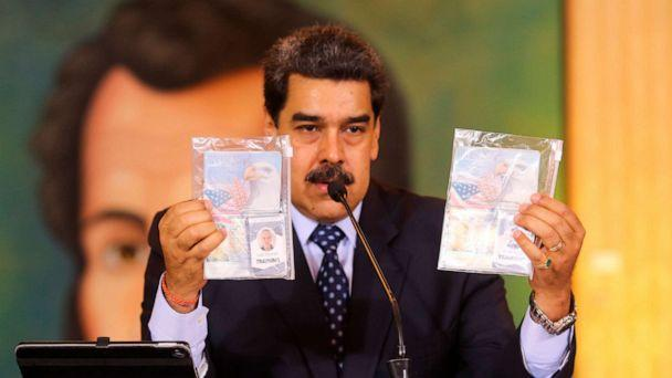 PHOTO: President Nicolas Maduro shows what Venezuelan authorities claim are identification documents of former U.S. special forces and U.S. citizens Airan Berry, right, and Luke Denman in Caracas, Venezuela, May 6, 2020. (Miraflores Palace presidential press office via AP)