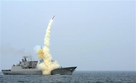 A South Korean navy destroyer launches an indigenous cruise missile during a drill at an undisclosed location