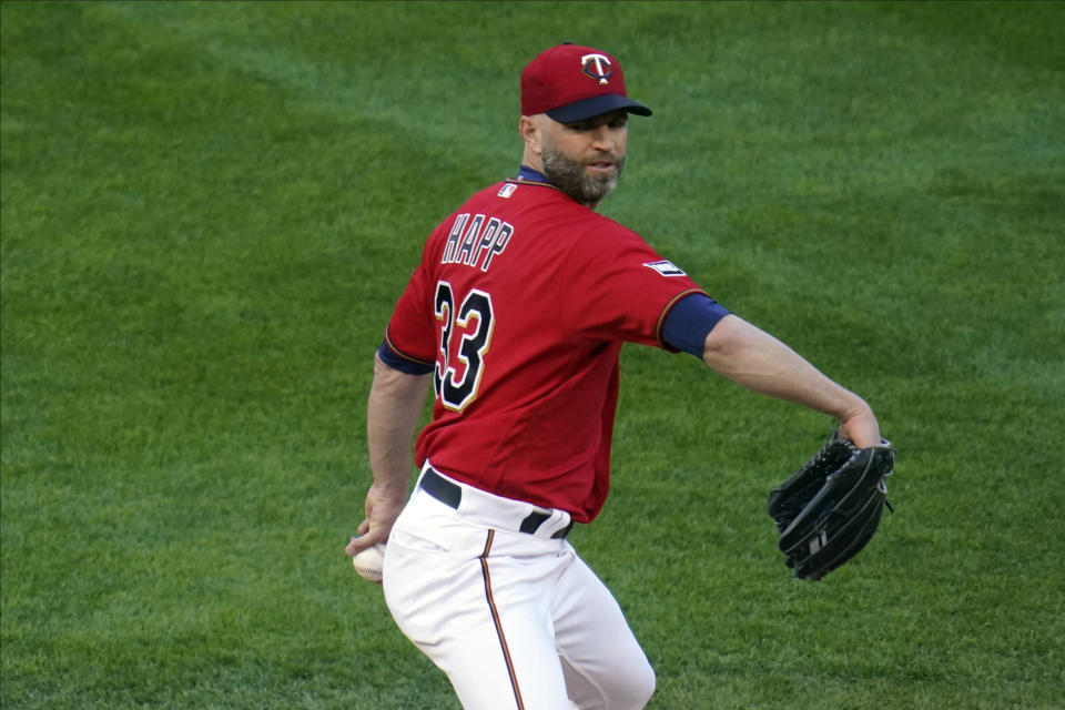 Minnesota Twins' pitcher J.A. Happ throws against the Texas Rangers in the first inning of a baseball game, Tuesday, May 4, 2021, in Minneapolis. (AP Photo/Jim Mone)