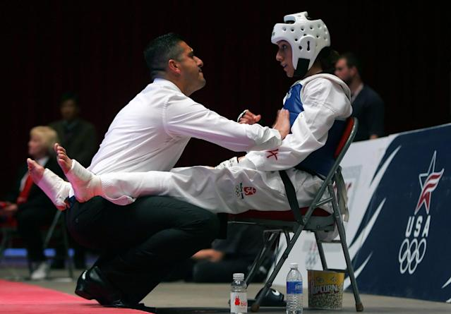 DES MOINES, IA - APRIL 05: Diana Lopez receives instructions from her brother and coach Jean Lopez during the Tae KwandoOlympic Trials match against Nia Abdallah at the Veterans Memorial Auditorium on April 5, 2008 in Des Moines, Iowa. Diana Lopez defeated Abdallah 1-0 in overtime to clinch a spot on the Olympic team. (Photo by Jeff Gross/Getty Images)