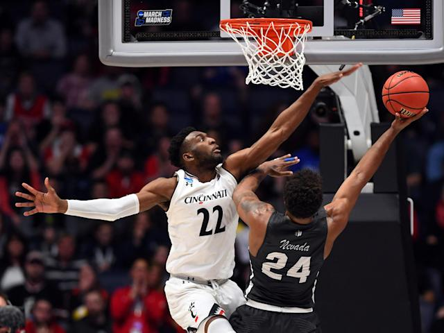 Mar 18, 2018; Nashville, TN, USA; Cincinnati Bearcats forward Eliel Nsoseme (22) defends against Nevada Wolf Pack guard Jordan Caroline (24) during the first half in the second round of the 2018 NCAA Tournament at Bridgestone Arena. Mandatory Credit: Christopher Hanewinckel-USA TODAY Sports TPX IMAGES OF THE DAY