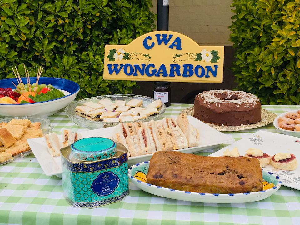 Food, including banana cake made by Meghan, Duchess of Sussex, is displayed as Britain's Prince Harry and Meghan visit the Woodley family at Mountain View Farm in Dubbo, Australia October 17, 2018. Paul Edwards/Pool via REUTERS