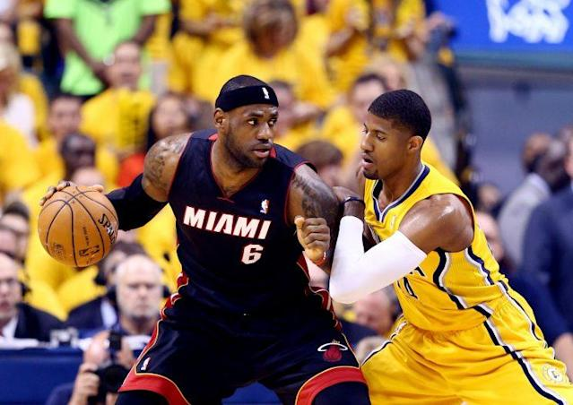 "<a class=""link rapid-noclick-resp"" href=""/nba/players/4725/"" data-ylk=""slk:Paul George"">Paul George</a> defends LeBron James in the 2014 playoffs. (Getty Images)"
