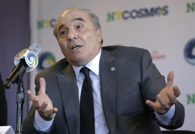 FILE - In this Tuesday, March 21, 2017 file photo, Rocco Commisso, speaks to reporters during a news conference in the Brooklyn borough of New York. Italian-American businessman Rocco Commisso has completed his takeover of Serie A club Fiorentina. Less than six months into his tenure as Fiorentina owner and president, Rocco Commisso is already starting to grapple with Italy's infamous bureaucracy as he attempts to build a new stadium for the club. First, Commisso's plan to overhaul the existing Stadio Artemio Franchi was rejected by the city committee that protects monuments. Now he is awaiting approval to build a new ground, perhaps near the city's airport. (AP Photo/Seth Wenig, File )