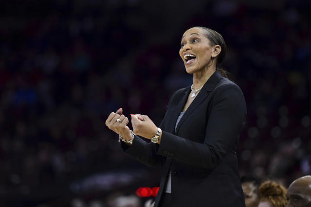 Auburn head coach Terri Williams-Flournoy communicates with players during the first half of an NCAA college basketball game against South Carolina, Thursday, Feb. 13, 2020, in Columbia, S.C. (AP Photo/Sean Rayford)