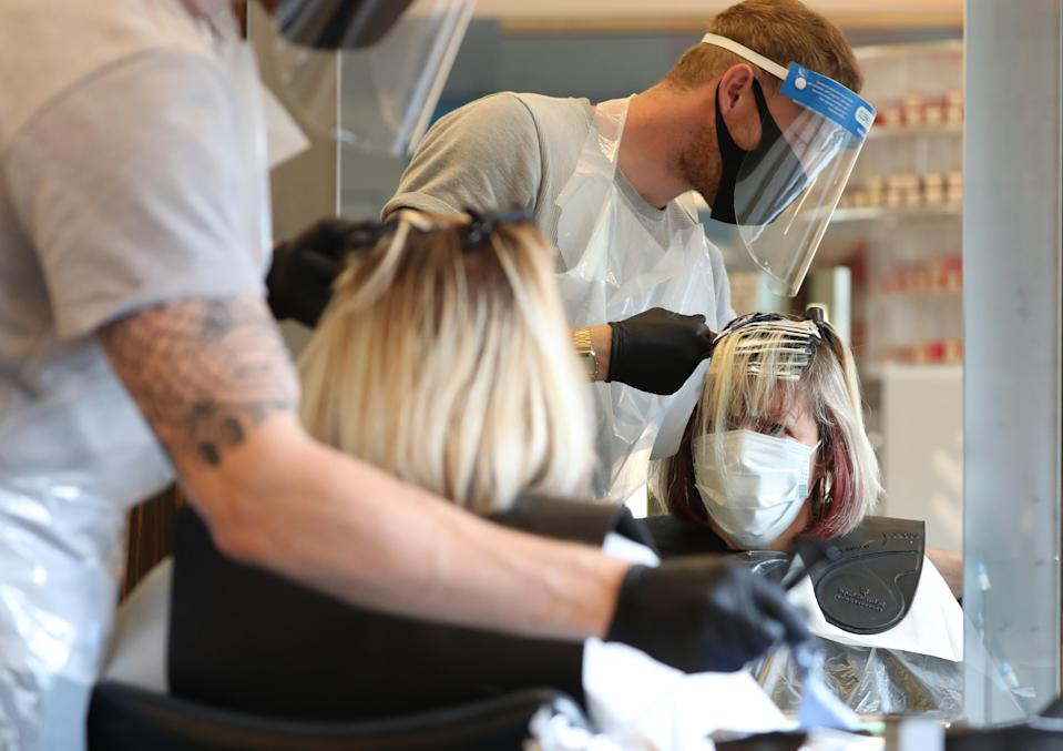 People can now get a haircut as long as the establishment is following the government guidelines. (Getty)