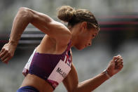 Sydney Mclaughlin, of United States, wins a heat in the women's 400-meter hurdles at the 2020 Summer Olympics, Saturday, July 31, 2021, in Tokyo. (AP Photo/Petr David Josek)