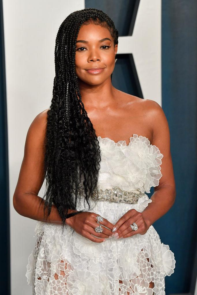 "Gabrielle Union revealed she was told her hair was ""too black."" (Photo by Allen Berezovsky/Getty Images)"