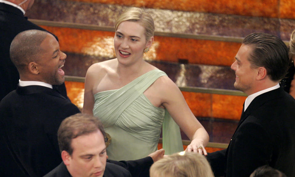 <p>The two pals chatted with Will Smith in the audience of the Oscars on February 25, 2007. Both Winslet and DiCaprio were nominated, though neither took home the statue. (Photo: Mark J. Terrill/AP)</p>