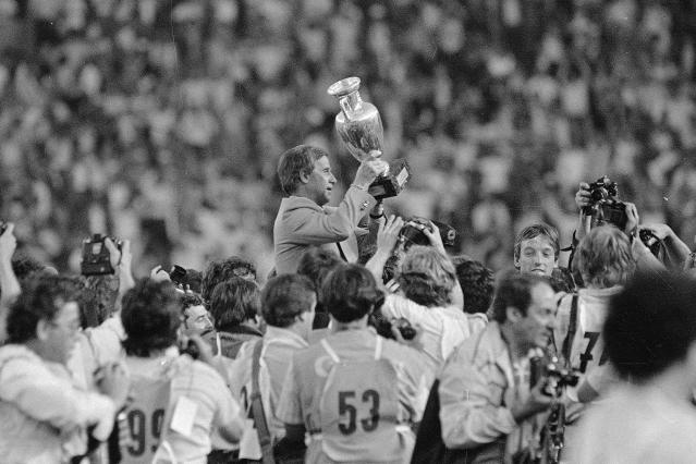FILE - In this June 27, 1984 file photo, French soccer team coach Michel Hidalgo raises the 1984 European Championship cup as he is carried across the Parc des Princes Stadium in Paris. The French Football Federation said on its website that Hidalgodied on Thursday March 26, 2020. He was 87. (AP Photo, FILE)