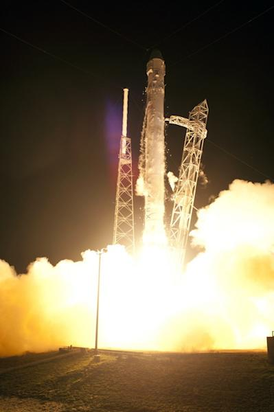 On Cape Canaveral Air Force Station in Florida, Space Launch Complex-40 is ablaze as the SpaceX Falcon 9 rocket lifts off at 3:44 a.m. EDT, May 22, 2012.