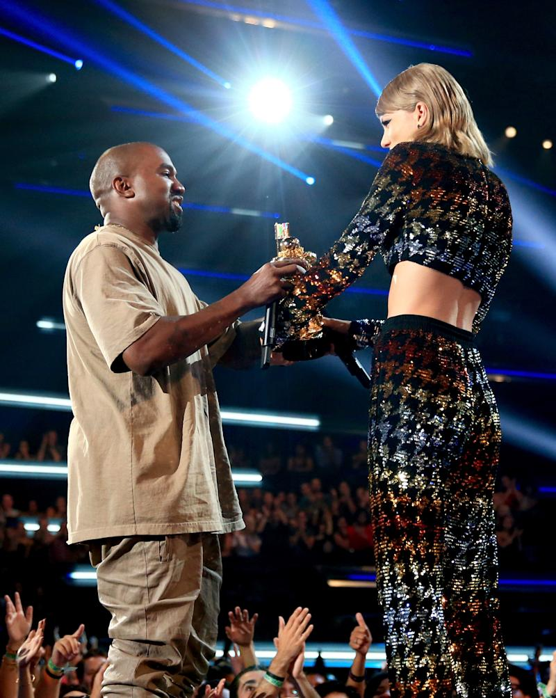 LOS ANGELES, CA - AUGUST 30: Recording artist Kanye West (L) accepts the Vanguard Award from recording artist Taylor Swift onstage during the 2015 MTV Video Music Awards at Microsoft Theater on August 30, 2015 in Los Angeles, California. (Photo by Christopher Polk/MTV1415/Getty Images)