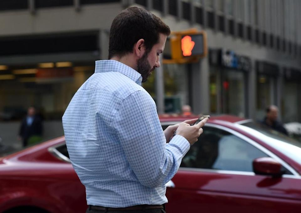 A Pew Research Center report found 68 percent of Americans use a smartphone, compared with 35 percent in 2011 (AFP Photo/Don Emmert)