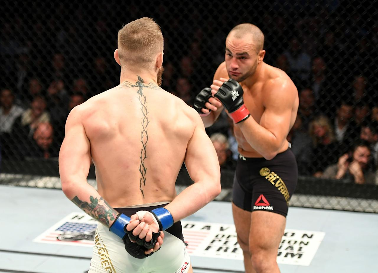 p eddie alvarez of the united states right fights against conor mcgregor