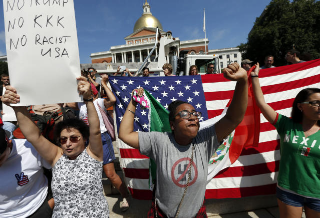 """<p>Counterprotesters hold signs and chant at the Statehouse before a planned """"Free Speech"""" rally by conservative organizers begins on the adjacent Boston Common, Saturday, Aug. 19, 2017, in Boston. (Photo: Michael Dwyer/AP) </p>"""