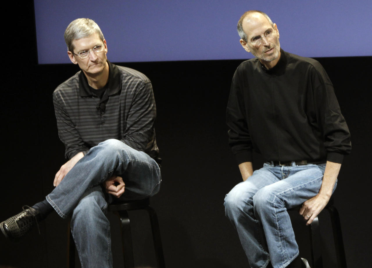 "<p> FILE - This July 16, 2010, file photo shows Apple's Tim Cook, left, and Steve Jobs, right, during a meeting at Apple in Cupertino, Calif. Apple wants to encourage millions of iPhone owners to register as organ donors through a software update that will add an easy sign-up button to the health information app that comes installed on every smartphone the company makes. CEO Cook says he hopes the new software, set for limited release in early July 2016, will help ease a critical and longstanding donor shortage. He said the problem hit home when his friend and former boss, Apple co-founder Jobs, endured an ""excruciating"" wait for a liver transplant in 2009. (AP Photo/Paul Sakuma, File) </p>"