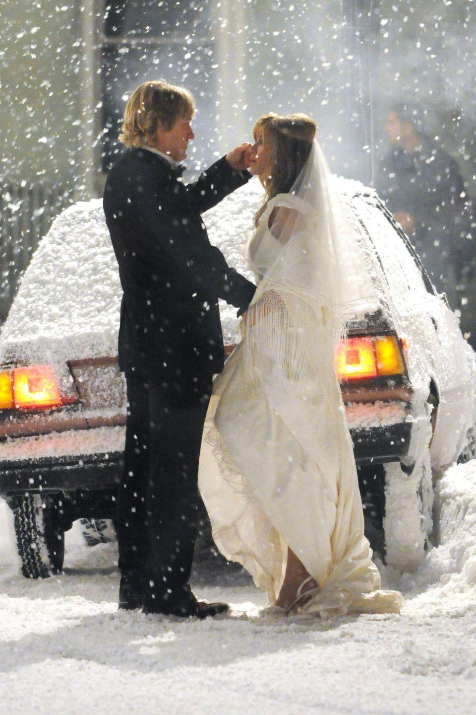 <p>Jenny's (Jennifer Aniston) winter wedding dress looked magical in a snowstorm, even though we imagine she was quite cold. The <em>Marley and Me </em>wedding took place at the very beginning of the movie, pre-Marley.<br></p>
