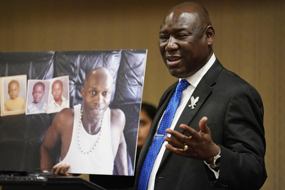 Attorney Ben Crump holds up a picture of Byron Williams during a news conference, Thursday, July 15, 2021, in Las Vegas. The family of 50-year-old Williams, whose death in Las Vegas police custody after a bicycle chase in 2019 was ruled a homicide, is suing the city and four officers they accuse of wrongful death and civil rights violations. (AP Photo/John Locher)