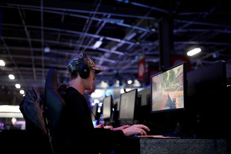 FILE PHOTO: A gamer plays PlayerUnknown's Battlegrounds (PUBG) at the Paris Games Week (PGW), a trade fair for video games in Paris