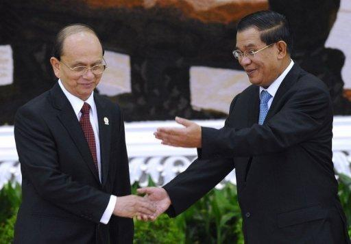 Myanmar's President Thein Sein (L) is greeted by Cambodian Prime Minister Hun Sen at the 20th summit of the Association of Southeast Asian Nation (ASEAN) in Phnom Penh. The ASEAN leaders called for all Western sanctions against Myanmar to be lifted in light of the vote